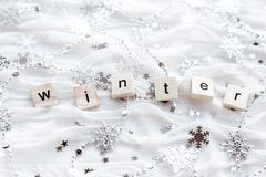 Winter background with decorative sparkling snowflakes and word WINTER. - stock photo