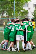 Members of the football team embrace after winning the match. Amateur footbal - stock photo