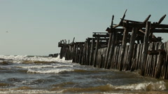 Old wooden breakwater. Bay. - stock footage