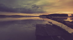 Vintage timelapse od beautiful sunrise over lake and old jetty. Stock Footage