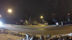 Cars going on street at winter night. Stock Footage