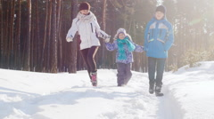 Happy family on a winter outing Stock Footage