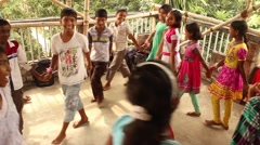Children playing in circle in a village in India Stock Footage