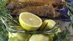 Marine fried fish with fresh herbs on the table Stock Footage