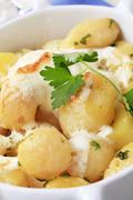 Potatoes and cream baked in a casserole dish Stock Photos
