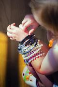 Little girl's hands with bracelets Stock Photos