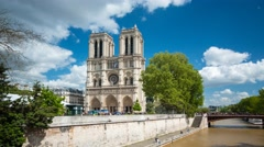 Bridge over the Siene river to Notre Dame Cathedra in Paris Stock Footage