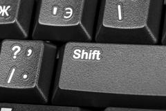 Electronic collection - detail black computer keyboard with key shift Stock Photos