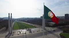 Portuguese Waving Flag on top of the Eduardo Park in Lisbon, Portugal Stock Footage