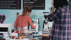 Female barista in cafe serving coffee Stock Footage