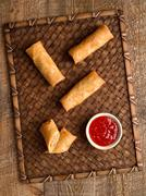 rustic golden chinese spring rolls - stock photo