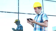 Engeneer with yellow helmet taking notes Stock Footage