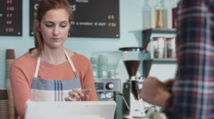Payment with contactless credit card in café Stock Footage