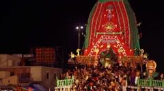 Priests fan the deity of Baladeva Prabhu with huge flags Stock Footage