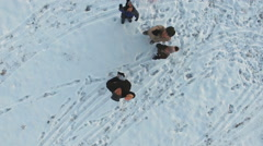 Fathers and kids having fun in winter, aerial view Stock Footage