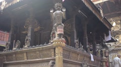 Figures in the Golden Temple in Patan, Nepal. Slider moution. Stock Footage