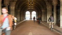 Time lapse of Bicyclists in the Rijksmuseum Building - Amsterdam Netherlands Stock Footage