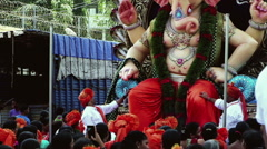 CROWD IN FRONT OF BIG IDOL ON GANESHA CHATURTHI IN MUMBAI [CC-CG, Emulation] Stock Footage