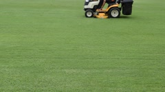 Mowing grass in a football stadium Stock Footage