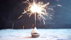 Cupcake with bow and candle - happy birthday card Holidays greeting card. - stock footage