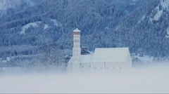 St. Coloman church in Aps, snowy winter Stock Footage