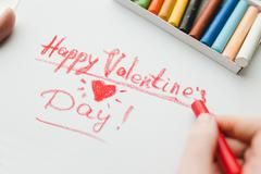 Happy Valentines Day - drawing with chalk on paper close up Stock Photos