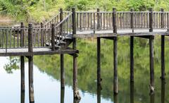 Old wooden bridge - stock photo