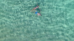 Stock Video Footage of Aerial view of couple relaxing in carribean sea