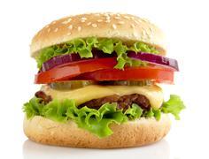 Big single cheeseburger isolated on white background Stock Photos
