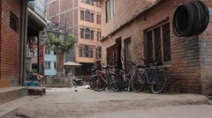 Courtyard with a bicycles and a sacred tree Stock Footage
