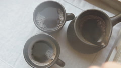 Two black coffee cups and clay ibrik on the wooden salver Stock Footage