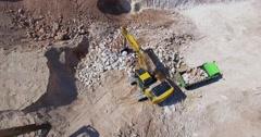 Aerial view of Industrial excavator loading soil Stock Footage