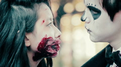 Young man and woman with terrible bloody makeup looking aggressively into camera Stock Footage
