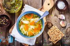 Chicken noodle soup with carrots and green onions Stock Photos