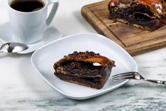 Slice of chocolate coffee cake ready to eat - stock photo