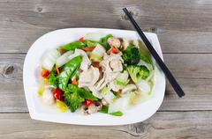 Stir fry white chicken and mixed vegetables ready to eat - stock photo