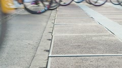 Bicycle wheels rolling across the road Stock Footage