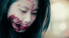 Close up of young female face with ugly bloody wound near mouth, schizophrenic Stock Footage