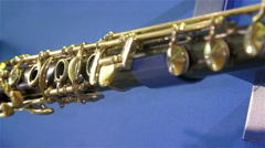 Side view look of the flute on a blue table Stock Footage