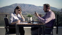 Young businesswoman talking on cellphone over documents with her partner Stock Footage