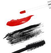 Stroke (sample) of black mascara and lip gloss, isolated on white macro Stock Photos