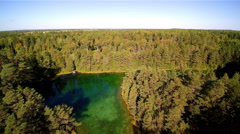 Antu lakes aerial shot with lots of trees surrounding Stock Footage