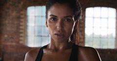 Kickboxing woman training punching bag in fitness studio Stock Footage