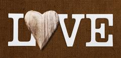 love text with wooden heart - stock photo