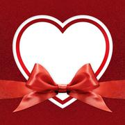 white heart border frame with red ribbon bow on red background - stock illustration