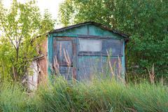 Abandoned garden house. - stock photo