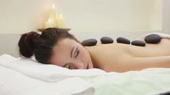 Stock Video Footage of Woman in spa salon with hot stones
