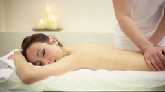 Attractive young woman relaxing with hand massage at beauty spa Stock Footage