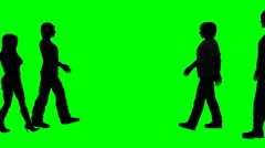 Four people silhouettes walk past each other on a green screen Arkistovideo