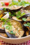 Grilled eggplant on rustic table Stock Photos